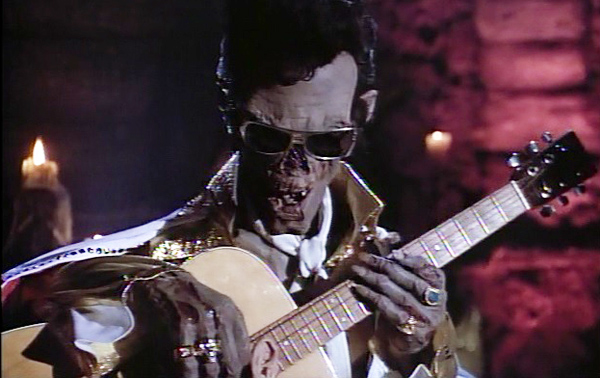 tales-from-the-crypt-season-4-3-on-a-deadmans-chest-crypt-keeper-elvis-guitar-sunglasses